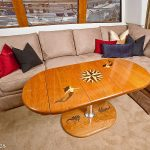 Boat cabin teak dining table with inlaid designs.