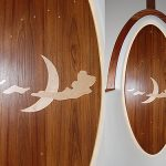 Teak overhead with inlaid designs for sailboat pilothouse.