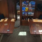 Twin Cruising Concepts' teak dining tables with folding leaves and inlaid compass rose.