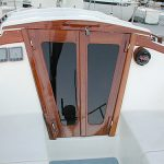 Teak companionway doors cut for the closest possible fit.