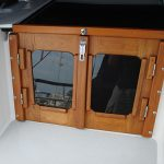 Teak companionway doors with stainless steel hinges.