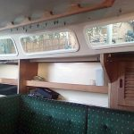 Interior view of a retrofit window installation showing the starboard plastic frames.