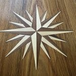 Freshly installed teak compass rose inlaid design.