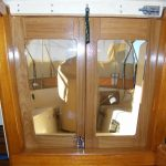 Teak companionway doors for an Island Packet 38 sailboat.