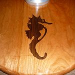 Seahorse inlaid carving installed in teak table foot.