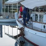 Cruising Concepts' teak boarding ladder installed on a sailboat.
