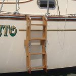 Unfolded teak boarding ladder ready for use.